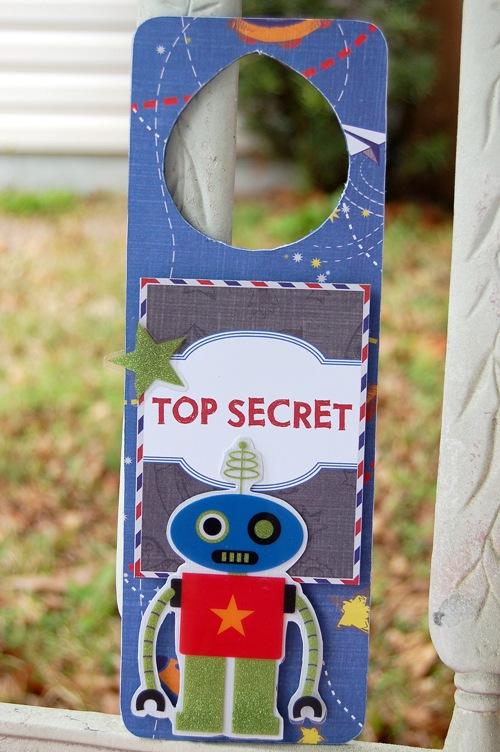 Charity Hassel-top secret door hang